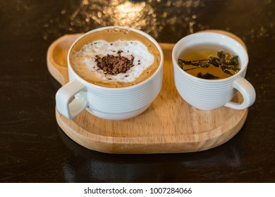 latte coffee cup and tea cup on wood table