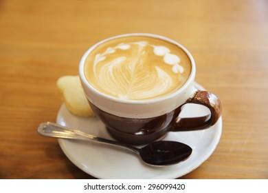 latte coffee on wood background