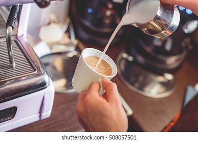 latte making process, soy milk mixing with coffee