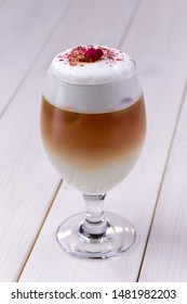 latte with rose on the wooden background