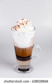 Latte with whipped cream on isolated white background