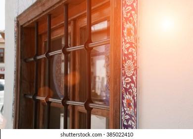Lattice on window of an old stone house