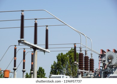 Lattice-type steel tower fragment over blue sky as a part of high-voltage line. Overhead power line details