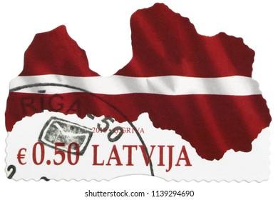 LATVIA - 2018: A contemporary postage stamp printed in LATVIA. Red white flag the Republic of Latvia, European Union (EU) Baltic country. Latvija Lettonie contours shape outline isolated macro closeup