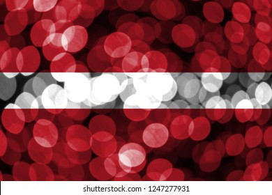 Latvia abstract blurry bokeh flag. Christmas, New Year and National day concept flag.