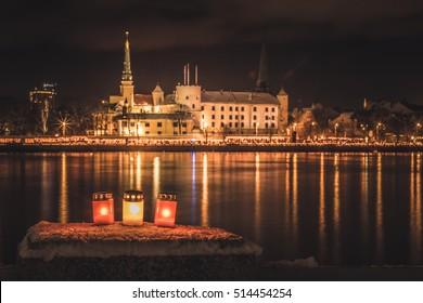 Latvia capital city Riga. Riga castle. River Daugava. Riga at night. Celebration of National holiday Lacplesa day. Winter at Riga. National symbol. Colors of Latvia flag. Proud to be latvian.