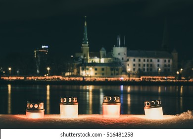 Latvia capital city Riga. Riga castle. River Daugava. Riga at night. Celebration of National holiday Lacplesa day. Winter at Riga. National symbol. Colors of Latvia flag. Proud to be latvian.