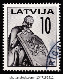 LATVIA - CIRCA 1992: A stamp printed in Latvia shows Ancient Warrior, fragment of the Brethren Cemetery, circa 1992.