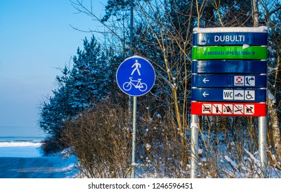 Jūrmala / Latvia - Des 2015: The information sign near the beach of Baltic sea in Dubulti district in Jūrmala, the famous Baltic resort at Christmas time. Winter in Baltic States.