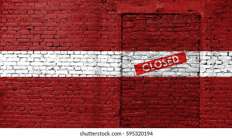 Latvia flag on brick wall with bricked door and Closed sign