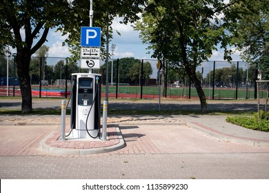 Cēsis, Latvia - July 16, 2018: electric vehicle car charging station in a public parking