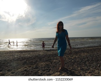 Latvia, Nida 25. August 2016, woman with her daughter by the sea