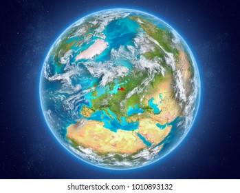 Latvia in red on model of planet Earth with clouds and atmosphere in space. 3D illustration. Elements of this image furnished by NASA.