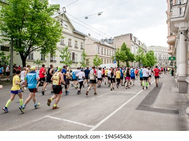 LATVIA, RIGA- 18 may, 2014: Competitors during the 2014 Nordea Riga marathon. Previous marathon on May 2013 gathered 22 020 runners from 65 countries on 18 may 2014