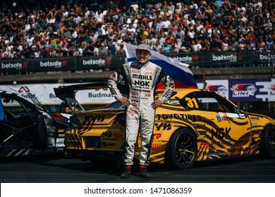 Latvia, Riga, Bikernieki Raceway - AUG 2, 2019: Drift Masters Riga Georgy Gocha Chivchan and Nissan Silvia S15 at the team parade