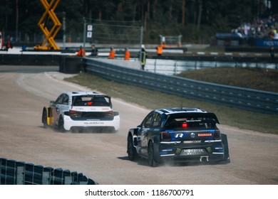 Latvia, Riga, Bikernieki Raceway - SEP 15, 2018: Neste World RX of Latvia Volkswagen Polo R RX try to overtake Audi S1 quattro RX