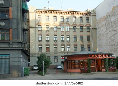 LATVIA, RIGA - JUNE 28, 2019: Latvian national romanticism in architecture, a fragment of the facade of the building, patio and restaurant