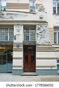 LATVIA, RIGA - JUNE 28, 2019: Fragment of the facade with the door of a residential building in the style of national romanticism on one of the central streets of Riga, Dragon at the main entrance