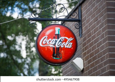 LATVIA - SEPTEMBER 6, 2016: Coca-Cola shield. The Coca-Cola Company is an American multinational beverage corporation and manufacturer, retailer and marketer.