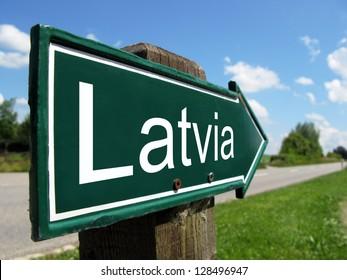 Latvia signpost along a rural road