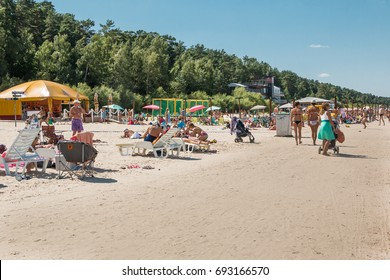 Latvia. Yurmala. August 9, 2017. Beach is 33 km (21 mi) long, covered with white quartz sand. People are sunbathing on a hot summer day.