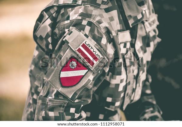 latvian-flag-on-military-uniform-600w-11