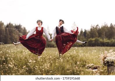 Latvian folk girls in traditional costume.