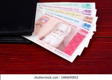 Latvian Lats in the black wallet