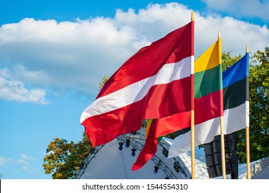 Latvian, Lithuanian and Estonian flags waving together, Latvia, Lithuania, Estonia, Baltic countries, united, independent, borders, Baltic travel bubble in summer