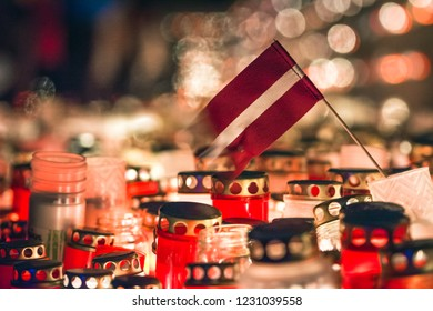 Latvian patriots lighting candles as a tribute to fallen freedom fighters. Hundreds of lighten up candles creating cosy atmosphere. Lāčplēša diena - day of independence of Latvia.
