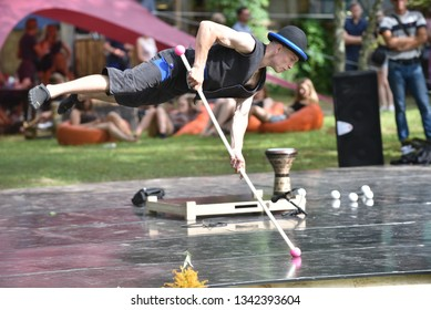 Latvian performer with performance at traditional street theater  on August, 2018 in Rezekne, Latvia. Hanging in the air without touching the ground.
