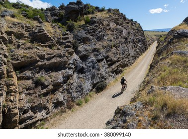 LAUDER, NEW ZEALAND - FEBRUARY 21, 2016: An unidentified man bikes in Otago central rail trail.