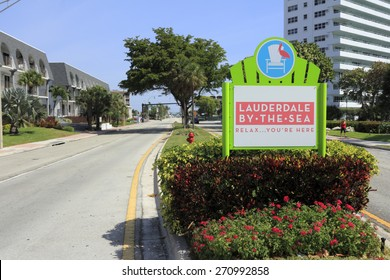 LAUDERDALE-BY-THE-SEA, FL, USA - APRIL 7, 2014: Lauderdale-By-The-Sea, Florida entrance sign in the median of Highway A1A seen from Fort Lauderdale which is south of the city.