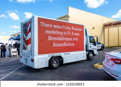 LAUDERHILL, FLORIDA, USA - NOVEMBER 10, 2018: A truck with LED signage drives past a vote counting protest outside Broward County Supervisor of Elections Brenda Snipes' office.