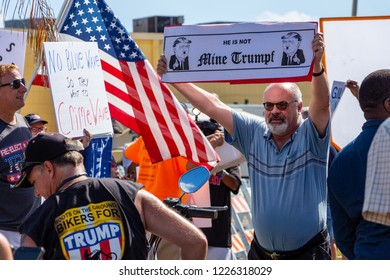 """LAUDERHILL, FLORIDA, USA - NOVEMBER 10, 2018: A man holds a """"Mine Trumpf"""" sign at vote counting protest outside Broward County Supervisor of Elections Brenda Snipes' office."""