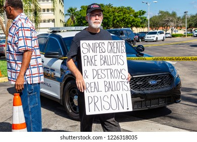 """LAUDERHILL, FLORIDA, USA - NOVEMBER 10, 2018: A man holds a """"fake ballots"""" sign at vote counting protest outside Broward County Supervisor of Elections Brenda Snipes' office."""