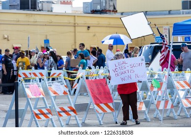 """LAUDERHILL, FLORIDA, USA - NOVEMBER 10, 2018: Woman holds a """"Desantis Won"""" sign at vote counting protest outside Broward County Supervisor of Elections Brenda Snipes' office."""