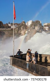 Laufen, Switzerland - 18 October, 2017: people on the platform at the Rhine Falls. The Rhine Falls is a waterfall in Europe, located on the border between the Swiss cantons of Zurich and Schaffhausen.