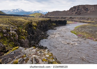 Laugavegur hiking trail. Cliffs of the river Innri-Emstrua. Mountain Tindfjallajokull covered with snow at the horizon. Highlands of Iceland. Segment of the trail between Hvanngil and Emstrur