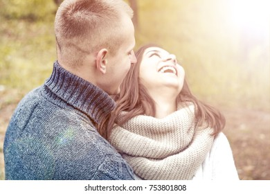 Laugh and joy on the girl's face. Happy couple. The concept of love.
