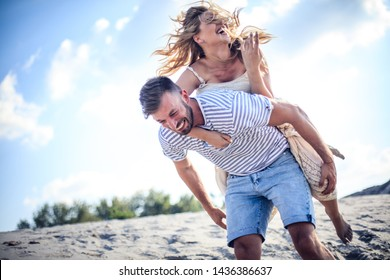 Laugh, summer, everything you need for love. Couple on sand.