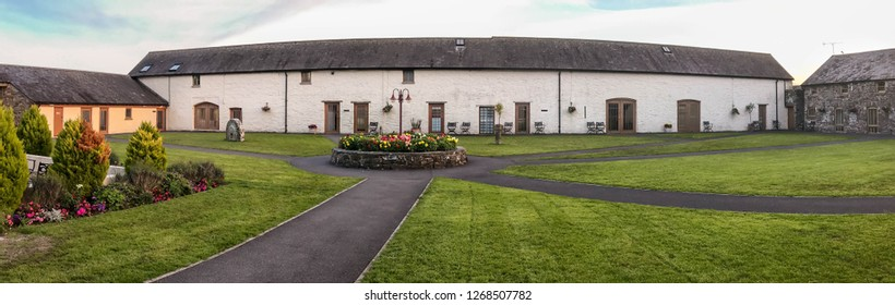 LAUGHARNE, CARMARTHENSHIRE, WEST WALES - AUGUST 2018: Panoramic view of accommodation buildings around the courtyard at the Corran Resort and Spa in Laugharne, West Wales.