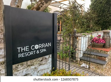 LAUGHARNE, CARMARTHENSHIRE, WEST WALES - AUGUST 2018: Sign outside the entrance to the Corran Resort and Spa in Laugharne, West Wales.