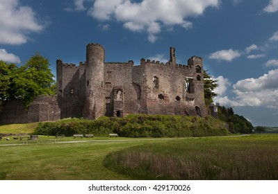 Laugharne Castle, a medieval castle on the river Taf estuary in Carmarthenshire, South Wales, with Dylan Thomas's Boat House tucked away to the right.