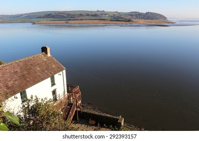 Laugharne, UK - December 29, 2014: The poet Dylan Thomas's boathouse sits on the estuary of the river Taf in Laugharne, Carmarthenshire, Wales.