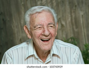 Laughing 90 year old senior man candid portrait