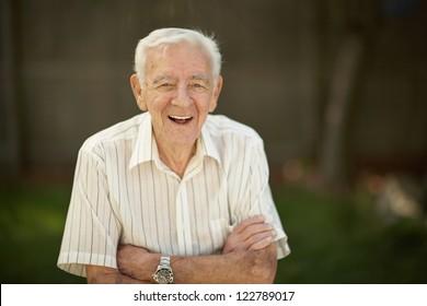 Laughing 90 year old senior elder man outside