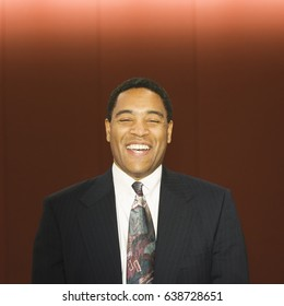 Laughing African American businessman