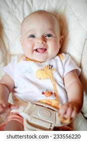 Laughing baby girl with food on her face.
