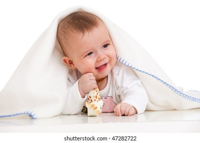 a laughing baby is holding its toy